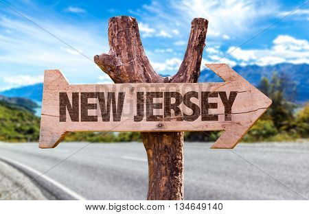 New Jersey wooden sign with road background