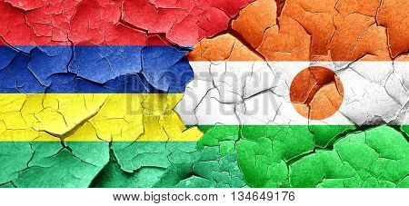 Mauritius flag with Niger flag on a grunge cracked wall