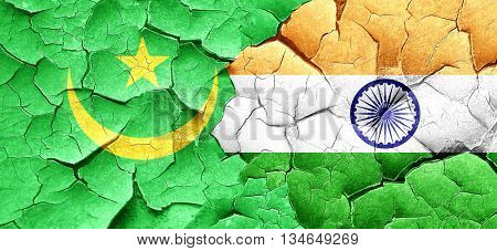 Mauritania flag with India flag on a grunge cracked wall