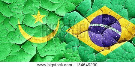 Mauritania flag with Brazil flag on a grunge cracked wall