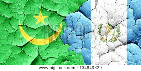 Mauritania flag with Guatemala flag on a grunge cracked wall