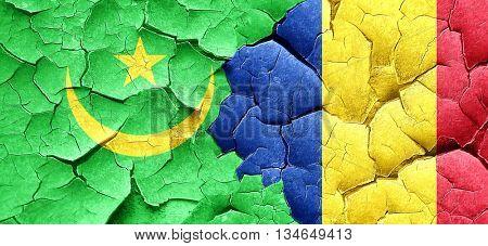 Mauritania flag with Romania flag on a grunge cracked wall