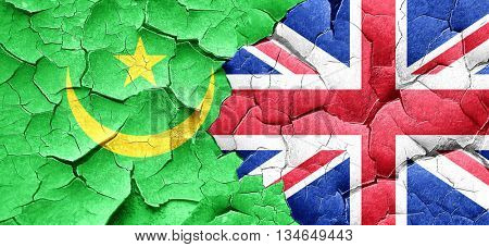 Mauritania flag with Great Britain flag on a grunge cracked wall