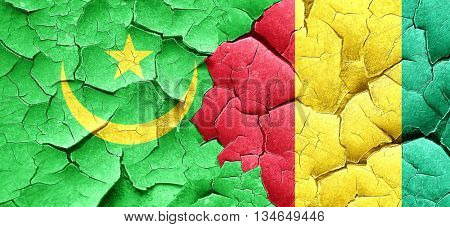 Mauritania flag with Guinea flag on a grunge cracked wall