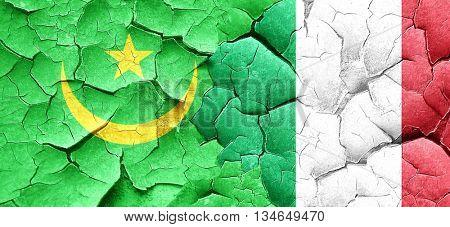Mauritania flag with Italy flag on a grunge cracked wall