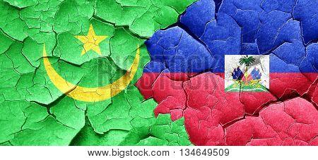 Mauritania flag with Haiti flag on a grunge cracked wall