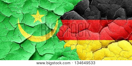 Mauritania flag with Germany flag on a grunge cracked wall