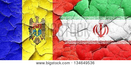 Moldova flag with Iran flag on a grunge cracked wall