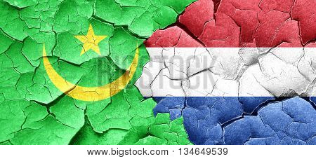 Mauritania flag with Netherlands flag on a grunge cracked wall