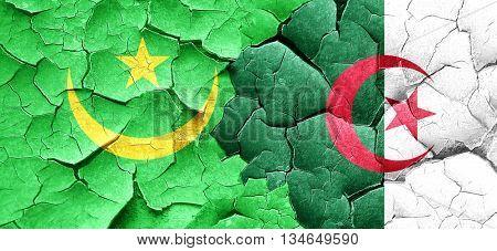 Mauritania flag with Algeria flag on a grunge cracked wall