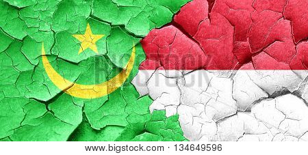 Mauritania flag with Indonesia flag on a grunge cracked wall