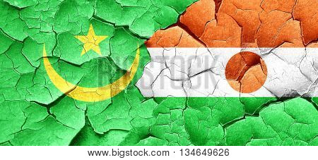 Mauritania flag with Niger flag on a grunge cracked wall