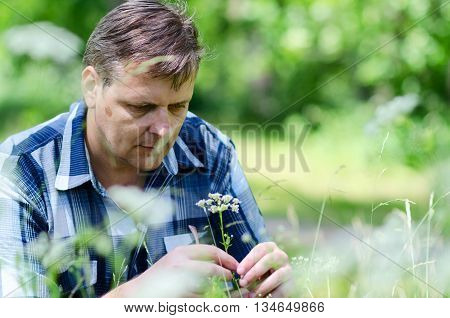 Melancholic man ponders serious problem during nature walk