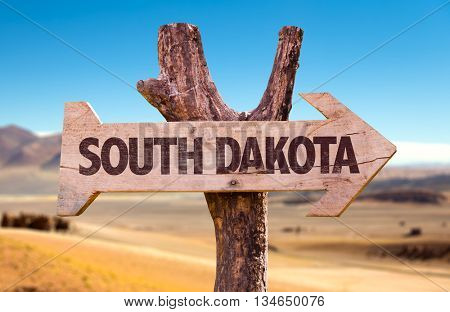 South Dakota wooden sign with desert background