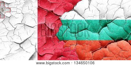 Malta flag with Bulgaria flag on a grunge cracked wall