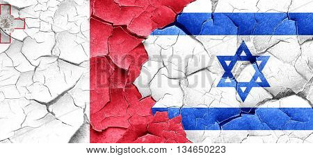 Malta flag with Israel flag on a grunge cracked wall