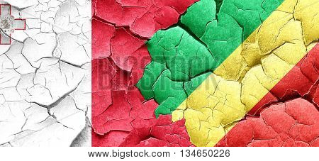 Malta flag with congo flag on a grunge cracked wall