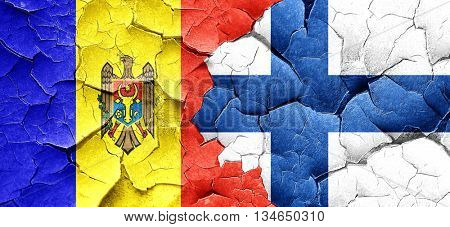 Moldova flag with Finland flag on a grunge cracked wall
