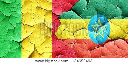 Mali flag with Ethiopia flag on a grunge cracked wall