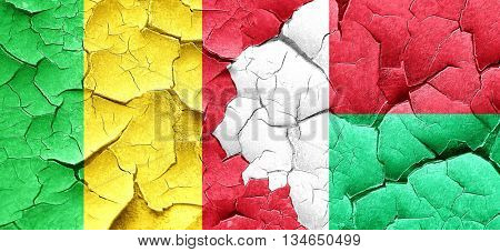 Mali flag with Madagascar flag on a grunge cracked wall