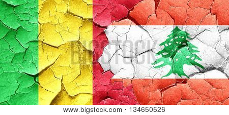 Mali flag with Lebanon flag on a grunge cracked wall