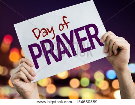 Day of Prayer placard with night lights on background