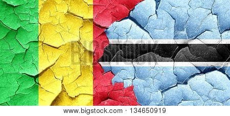Mali flag with Botswana flag on a grunge cracked wall