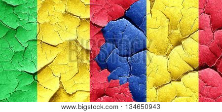 Mali flag with Romania flag on a grunge cracked wall