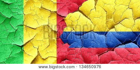Mali flag with Colombia flag on a grunge cracked wall