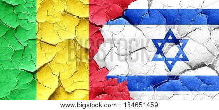 Mali flag with Israel flag on a grunge cracked wall