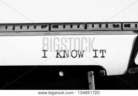 Typewriting on an old typewriter. Typing text: i know it