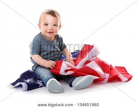 Adorable baby boy and American flag, isolated on white