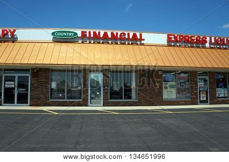 SHOREWOOD, ILLINOIS / UNITED STATES - AUGUST 21, 2015: Country Financial offers auto, home, and life insurance, plus retirement products, in a Shorewood strip mall.