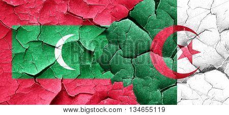 Maldives flag with Algeria flag on a grunge cracked wall