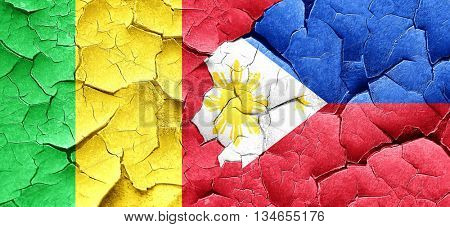 Mali flag with Philippines flag on a grunge cracked wall