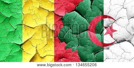 Mali flag with Algeria flag on a grunge cracked wall