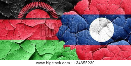 Malawi flag with Laos flag on a grunge cracked wall