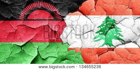 Malawi flag with Lebanon flag on a grunge cracked wall