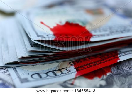 One hundred dollars banknotes with bloodstains