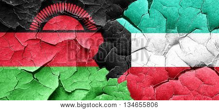 Malawi flag with Kuwait flag on a grunge cracked wall