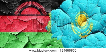Malawi flag with Kazakhstan flag on a grunge cracked wall