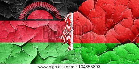Malawi flag with Belarus flag on a grunge cracked wall