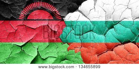 Malawi flag with Bulgaria flag on a grunge cracked wall