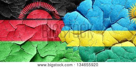 Malawi flag with rwanda flag on a grunge cracked wall
