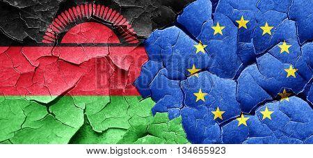 Malawi flag with european union flag on a grunge cracked wall