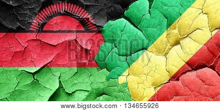 Malawi flag with congo flag on a grunge cracked wall