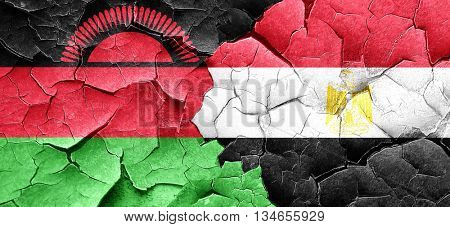 Malawi flag with egypt flag on a grunge cracked wall