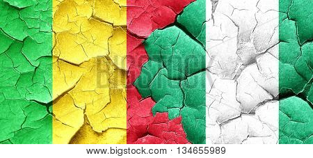 Mali flag with Nigeria flag on a grunge cracked wall