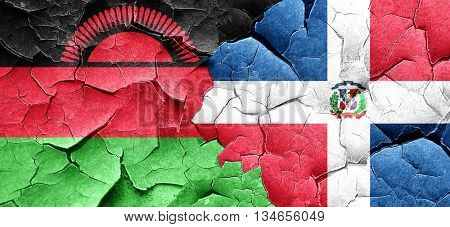 Malawi flag with Dominican Republic flag on a grunge cracked wal