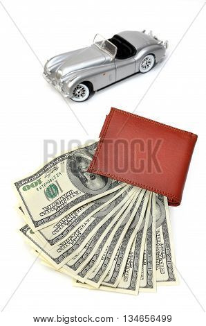 Wallet with US Dollars and blured old car background